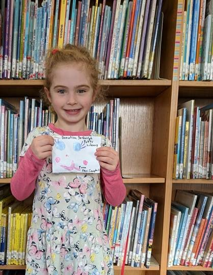 Meet Peri. She recently donated money from her birthday party to help the library!