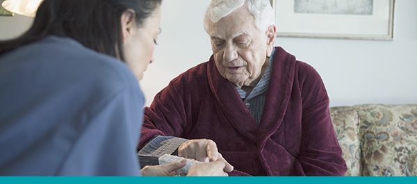 Elderly man receiving health care at home