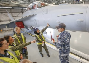 Air Force Aviation Camp for Women participants have a close look at a No. 6 Squadron EA-18G Growler.