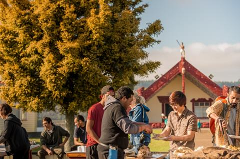 Image of different families outside a Marae