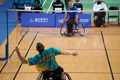 Two people playing para-badminton