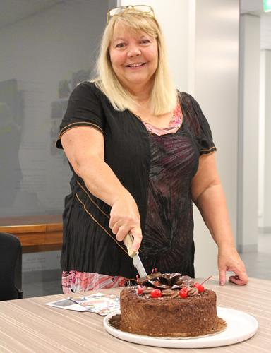 Woman cutting a cake