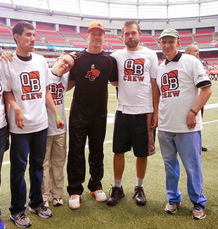 Travis Lulay on the BC Place sidelines with SOBC athletes