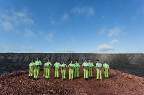 People in a quarry wearing green jump suits