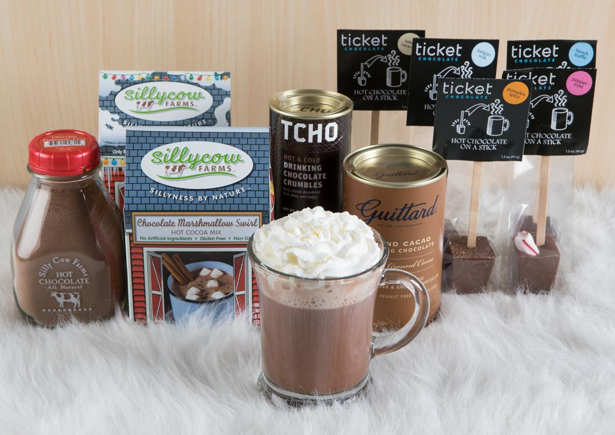hot chocolate boxes and a cup with whip cream