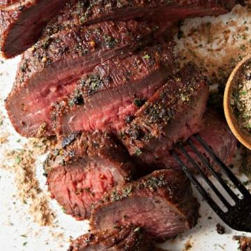 Sliced tri-tip roast with dry rub