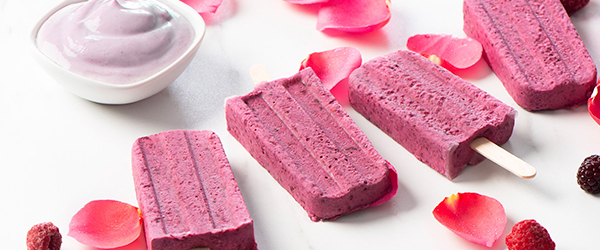 Photo of homemade berry popsicles with a side of blueberry acai Nordica smooth.